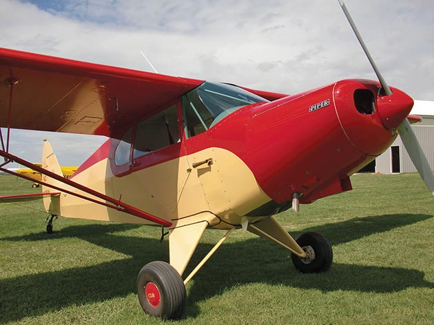 Many volunteers at Stanton Airfield fly, maintain and even restore hobby planes such as this colorful Piper.