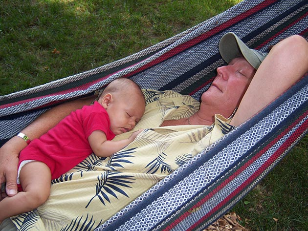 Spending time outdoors with grandchildren has been an important part of Don Shelby's life, including hammock napping with his grandson, Hudson.