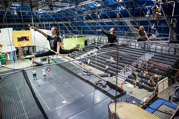Students practice the splits on the high wire at Circus Juventas, which has a domed vinyl and aluminum-frame roof, plus bleachers to seat 940 people for periodic performances. Photo by Dan Norman