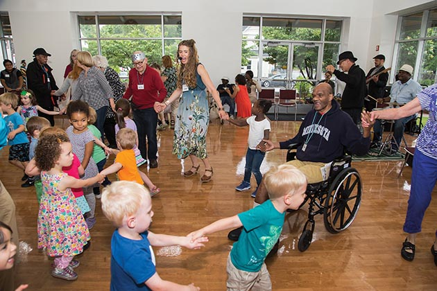 Maria Genné's community dance company, Kairos Alive!, hosted an Intergenerational Dance Hall at East Side Neighborhood Services' Adult Day at Friendship Center in Minneapolis in June. Photo by Tracy Walsh