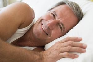 happy senior in bed