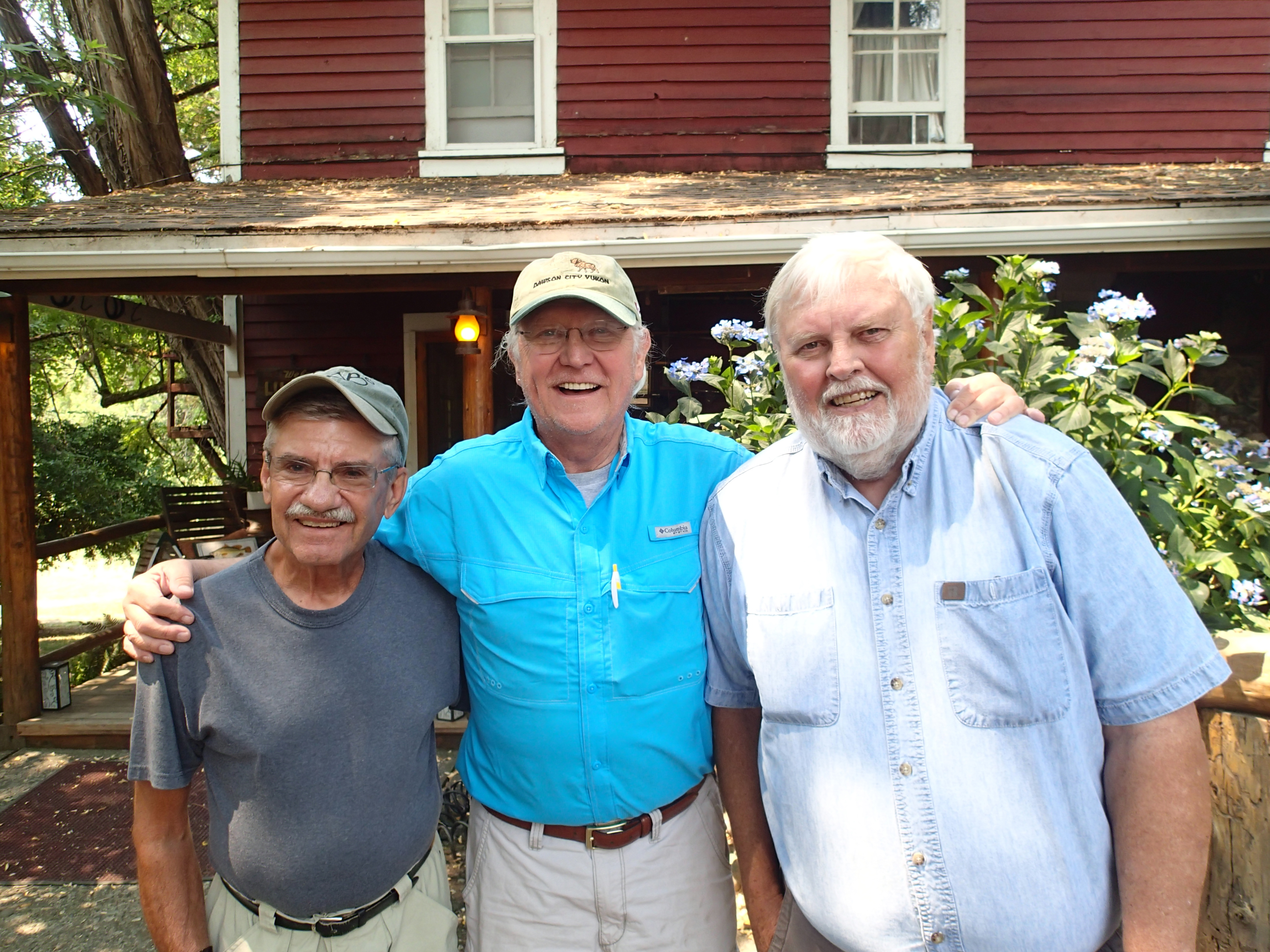 Dave Nimmer, Don Shelby and Rod Sando pose in front of a fishing lodge near Agness, Oregon.